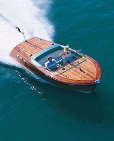 """I think this is a classic Chris-Craft boat circa 1950s??  BEAUTIFUL!  I want to go to """"On Golden Pond!"""""""