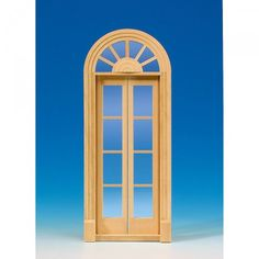 Palladio door, with acrylic glass panes (60165). Palladio door made of natural wood, two-leaf like # 60160, but with acrylic glass panes, lattice strips and interior paneling. Dimensions: 86 x 210 mm, cut-out dimensions: 78 x 208 mm.