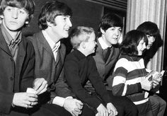 The Beatles had so much time for their fans. Here's a rare photograph from 1964, where the band are spending time with two young Beatlemaniacs.