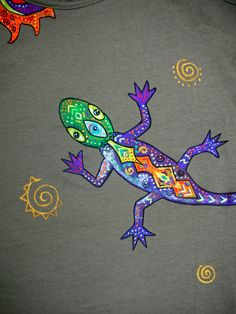 Hand painted tank-top with professional acrilic paints. In single copy. You dont meet people in a same clothes. Picture from series  Psychedelic creatures. On both sides. Hand or delicate machine wash in warm water.  Khaki tank-top with psychedelic lizard. Size S , but will be good on size M too.  ATTENTION! If you like 2 t-shirts (or more), you can buy it together in one order and economy on delivery.  MORE PAINTED T-SHIRTS and TOPS you can find in my shop…
