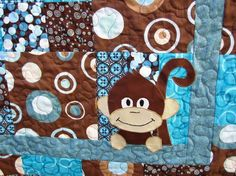 Teal and Brown Baby Quilt with Appliqued Monkey in the Corner