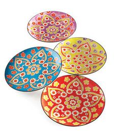 "Vagabond Vintage's Lotus ceramics pop with exuberant flower patterns and colors. The hand-painted dessert plates measure 8"" dia. and are dishwasher safe. The set of four, which includes one of each color, costs $70. 404-351-6484; mothology.com"