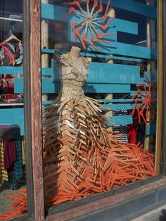 anthropologie RETAIL STORE window display dress made from wooden hangers and wooden clothespins