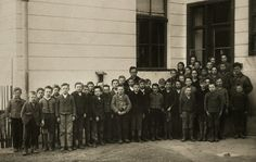 Wittgenstein with students and a colleague, in front of the school in Otteral, 1923