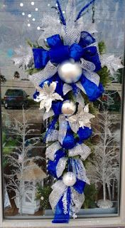 Blue silver door swag designed by Arcadia Floral Home Decor Decorations Christmas, Blue Christmas Decor, Christmas Mesh Wreaths, Christmas Swags, Christmas Colors, Christmas Themes, Christmas Crafts, Christmas Ornaments, Burlap Christmas