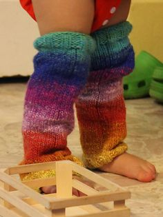 This is a very easy pattern, nothing but ribbing and stocking stitch, in the round. Bernat Mosaic is the perfect easy-care self-striping yarn for busy mommas. These little legwarmers are a stylish way to protect a little crawler's knees, or to keep baby's legs warm while in a wrap or carrier.