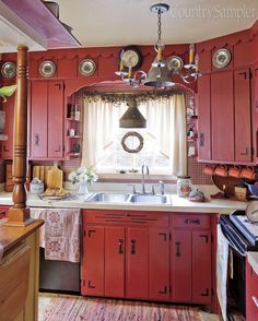 Red Kitchen Cupboards... I am liking these red cupboards.. would be ...