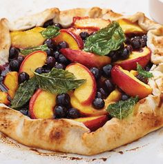 Peach Blueberry Galette with Basil Cream is the perfect mix of sweet and savory. Not a fan of basil? The galette, really a free-form pie, is delicious without the fried basil leaves and basil cream accompaniments.