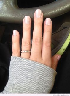 Simple classy manicure, grey sweater and a thin band ring.