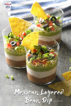 Turn your next BBQ into an all out fiesta with these fun, flavorful Mexican Layered Bean Dip cups!