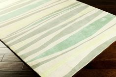 Shades of sea greens and teals sculpted luxury wool area rug