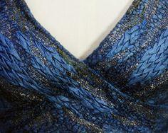 Daenerys, 3ª temporada. Para este vestido, a estilista Michele Clapton queria um bordado texturizado com detalhes lembrando escamas de dragões.