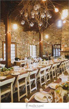 Rustic wedding decor, branch chandelier, would be prettier with round tables, I think.