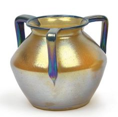 A vase with three handles,  Lötz Witwe, Klostermühle after 1918, the colourless glass covered with a dense pattern of silver-yellow specks, with applied blue handles and rim line with silver-yellow specks, iridescence, height 13.2 cm