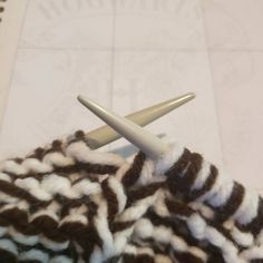 """Brown and white slippers to be added to the inventory soon. Up next on the needles, pink and blue"""
