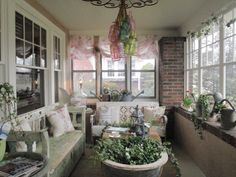 Enclosed front porch, she used a old tub as a planter/coffee table, the light fixture is pretty too.