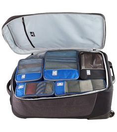 organized suitcase. packing cubes. The Container Store