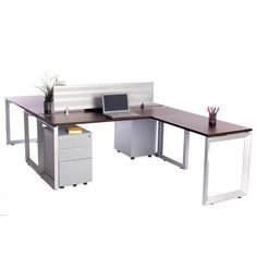 Workstation for 2! This back to back set of desks is space-saving and functional. Modern, flat silver legs, rich brown teak tops and privacy divider. Includes 2