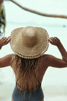 Perfect summer hat which is hand made from organic Raffia straw harvested on the island of Madagascar. Vented crown allows cool air flow, while the wide brim provides for essential sun protection. Easily packed away for your next holiday!