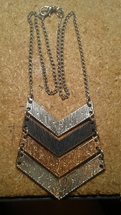 Check out this item in my Etsy shop https://www.etsy.com/listing/600304921/metal-chevron-necklace