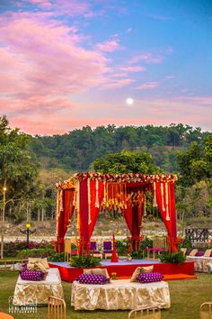 Wedding Decor - Gold and Purple Decor with Red Mandap | WedMeGood | Beautiful Red Mandap Setup in a Open Forest Backdrop #wedmegood #mandap #decor #indianwedding #indiansetup #weddingdecor #indianweddingdecor #decor