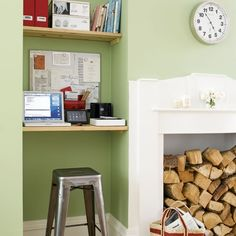 Fantastic work space created in fireplace alcove. Living room office features green walls and floating desk with shelving using plank boards. Fireplace with floating desk and Tole Stool. Tiny Home Office, Small Home Offices, Small Space Office, Home Office Storage, Home Office Space, Home Office Design, Office Spaces, Work Spaces, Design Desk