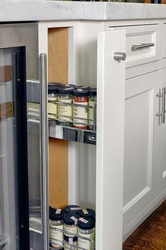 A spice-cabinet pullout makes use of a sliver of space.   Photo: Ken Gutmaker   thisoldhouse.com