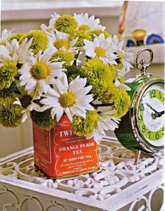 I think the idea of using old tea tins as flower vases is great! Tin Flowers, Pretty Flowers, Flower Vases, Paper Flowers, Floral Centerpieces, Floral Arrangements, Orange Pekoe Tea, Vintage Tee, Container Flowers