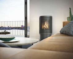 The natural gas versions of the Viva wood stove, the gas series brings the beautiful design and impeccable build with the convenience of gas Gas Fireplace, Fireplaces, Gas Fires, Gas Stove, Ceiling Lights, Modern, House, Stoves, Design