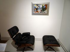 A painting by Ray Kaiser Eames hangs about the Eames Lounge Chair and Ottoman by Charles and Ray #Eames at The Columbus Museum in Georgia!