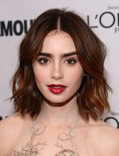 Lilly Collins' dark brunette bob is stunning with loose waves. This look is perfect for the red carpet, work and evening out.