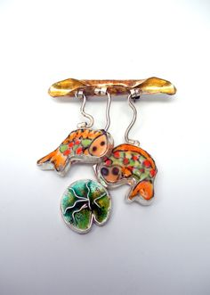Koi Pond Brooch by Laura Stamper Designs. American Made. See the designer's work at the 2016 American Made Show, Washington DC. January 15-17, 2016. americanmadeshow.com #americanmadeshow, #americanmade, #jewelry, #brooch, #koi, #fish