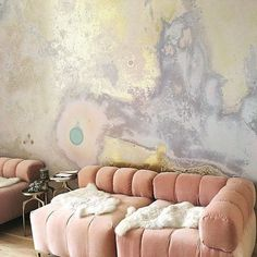 pink puffy couches and walls