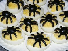 Spider Deviled Eggs  ------  Halloween deviled eggs gettin' a little creeeeeeeeppy!! They'll be the talk of your party!
