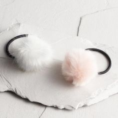 One of my favorite discoveries at WorldMarket.com: Pink and Ivory Pom Hair Ties Set of 2
