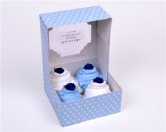 4 beautiful short sleeved bodysuits presented in a pretty spotted cake box. The parents will be delighted to receive this thoughtful baby shower g ...