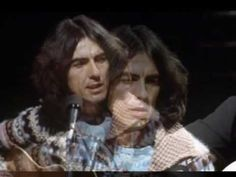 George Harrison  and Paul Simon sing here Comes the Sun,   on Saturday Night Live