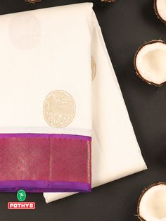 The beautiful white Kanchipuram saree with traditional butties with the intricate patterns of pure gold embroidery in the border is perfectly blended with the violet border displaying the unnerving charm for this festival season. #silksaree #puresilk #saree #traditionalsaree #sareedesigns #sareestyles #weddingsaree #sareelook #diwali #bridalsaree #sareeembroidery #diwalispecial #diwalicollection #silksaree #silksareeblouse #weddingsilks #kancheepuramsilk #weddingblouse #southindianwedding