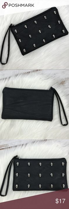 "NWOT Black Skull Wristlet Black faux leather clutch with silver skulls. NWOT. L = 7"" H = 4.5"" Quite roomy despite its size! Easily holds all the essentials - phone, money, lipstick, etc. Bags Clutches & Wristlets"