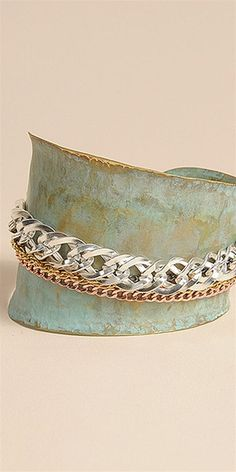 This cuff features an oxidized metal body with 4 assorted chain links at center.- Color: oxidized metal silver gold bronze nickel