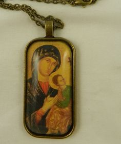 Glass tile religious pendant with a Greek Orthodox  icon image of the Virgin Mary, Theotokos.