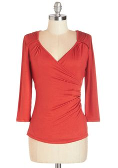 Seemingly Sew Top in Cinnamon - 3/4 Sleeves. Like the paintings at your neighborhood art show, your rust-orange top is simple at first glance, but a closer look reveals the mastery of its surplice neckline, flattering seams, and subtle ruching. #red #modcloth