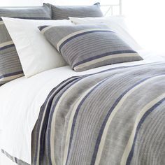 Boho bedding is a breeze with this African-inspired, striped linen/cotton duvet cover. The subtle detailing in the broad indigo stripes give this duvet cover a traditional-with-a-twist look that's perfect for layering with intricate patterns and embroidered pillows and throws.  • 50% linen/50% cotton.  • Knife edge.  • Horizontal stripe.