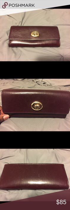 """Turnlock Slim Envelope Wallet in Smooth Leather Bordeaux colored leather. Twelve credit card and multifunctional pockets. Full-length bill compartments. Outside open pocket. Zip coin pocket. Turn lock closure. 7 3/4"""" (L) x 4"""" (H).  Barely used. Coach Bags Wallets"""