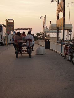 """Family biking along the Rimini beachfront"" - ""Intro to BlogVille Rimini. The sunset in Emilia-Romagna"" by @keaneiscool"