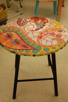 The mosaic table with paisleys I design for a fundraising sale.