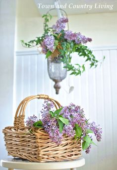English Ivy and Lilacs - with a little more filler would make nice wedding centerpieces? white basket?