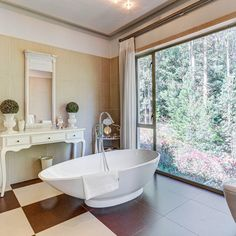 A stunning bath tub with an even more stunning view. What could be better? Bath Tub, Clawfoot Bathtub, Built In Braai, 6 Seater Dining Table, Forest Hill, Have A Shower, Double Beds, Maine House, Two Bedroom