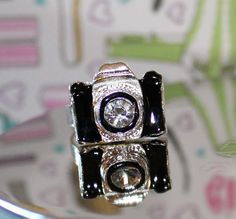Adjustable resin camera ring with a rhinestone in the center - via Etsy.