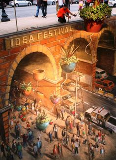 3D street art — alternatively known as pavement, chalk or sidewalk art — is a form of anamorphic art that sprawls over sidewalks, walls, and public spaces. In this form, artists use chalk or pastels to render pictures that use mathematical continuation of perspective to give the illusion of three-dimensionality. Though the medium is widely regarded as a modern art, street art traces its origins back to the Renaissance.